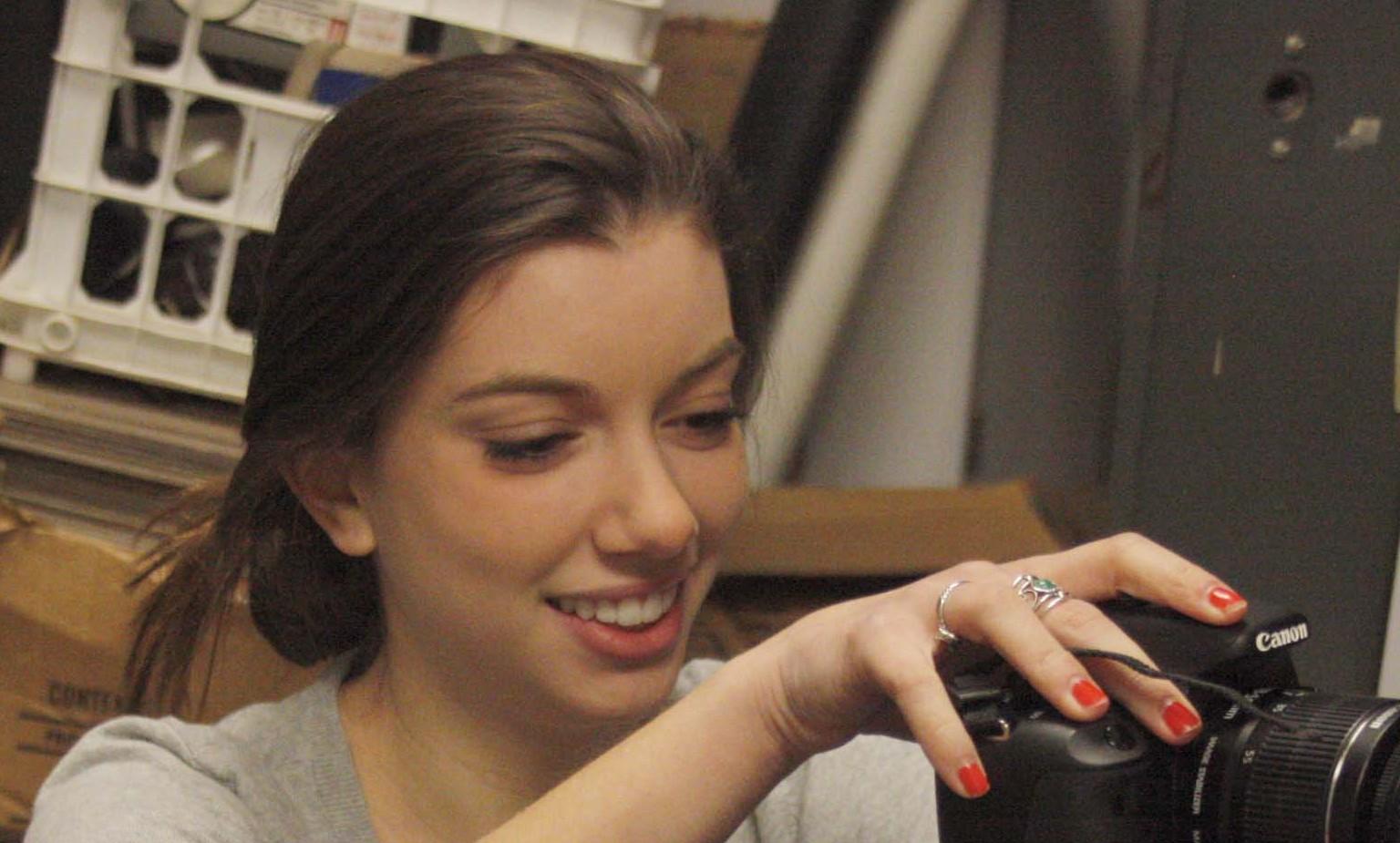 Junior Bethany Lehman sets up a camera.