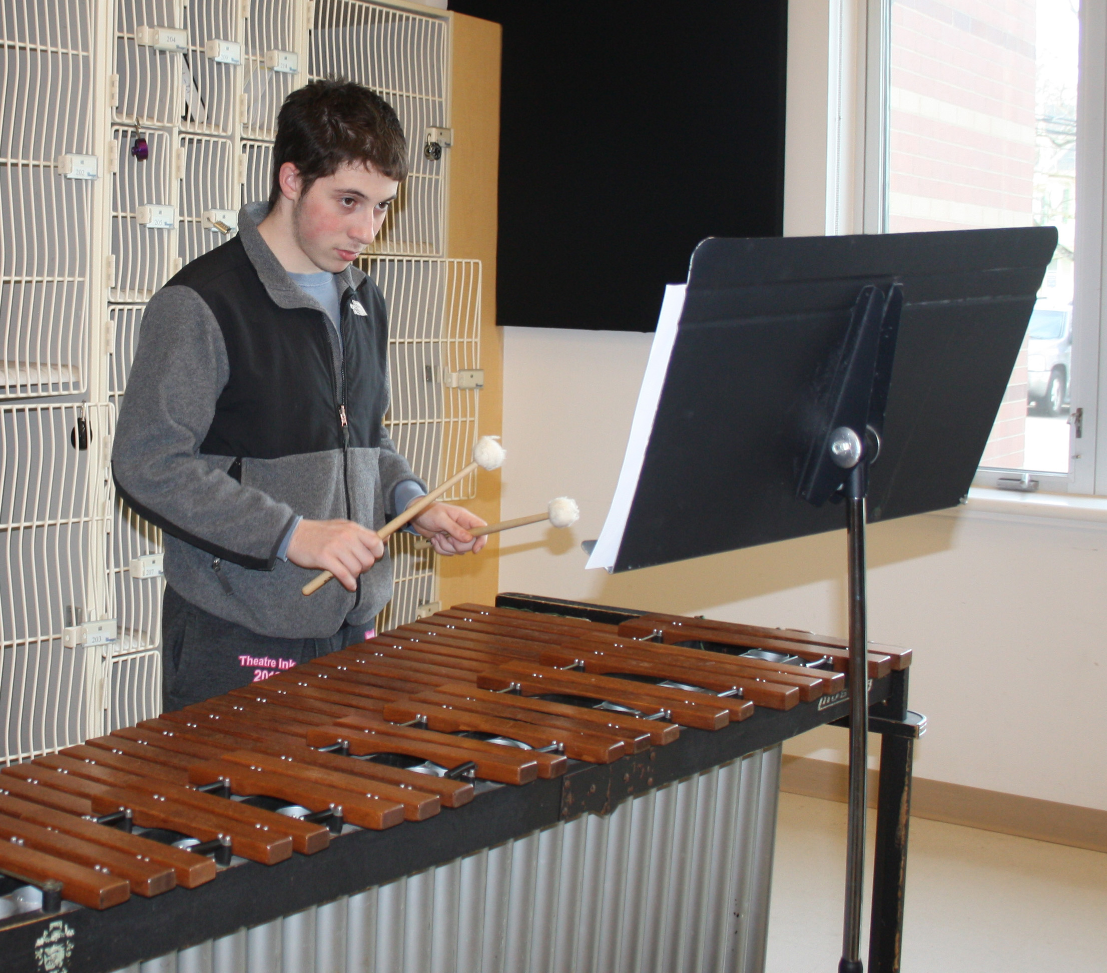 Senior Billy Cohen prepares for Winterfest with the rest of the members of Wind Ensemble.