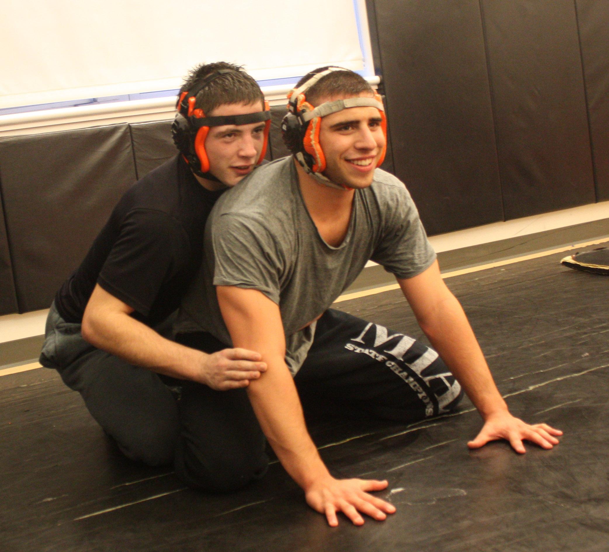 Senior Nick Mariano wrestles with Jordan Long '12 in the dance studio Friday.