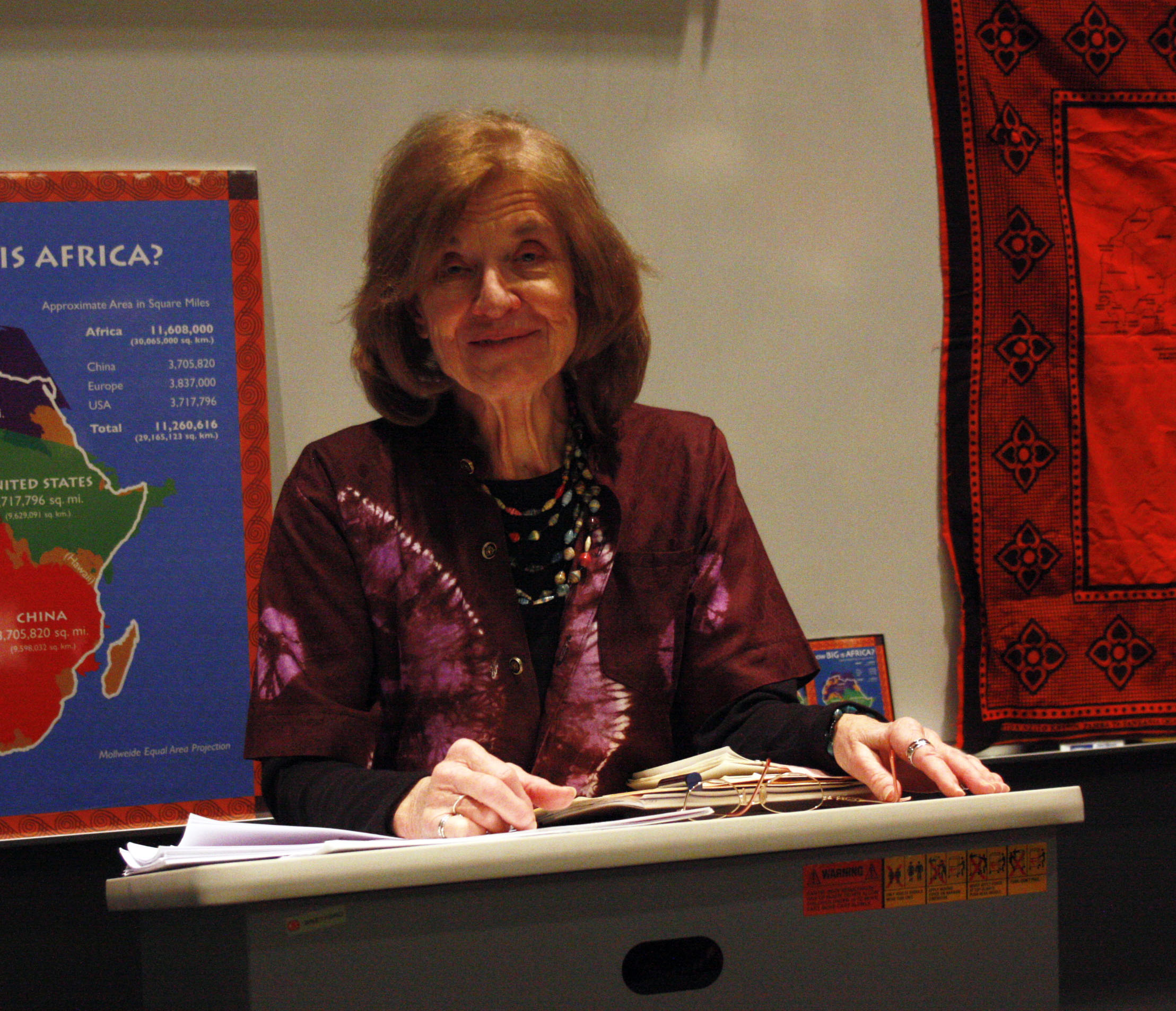 Former teacher Anne Serafin presents a poetry anthology written by 16 African woman during the Huntington Lecture yesterday.