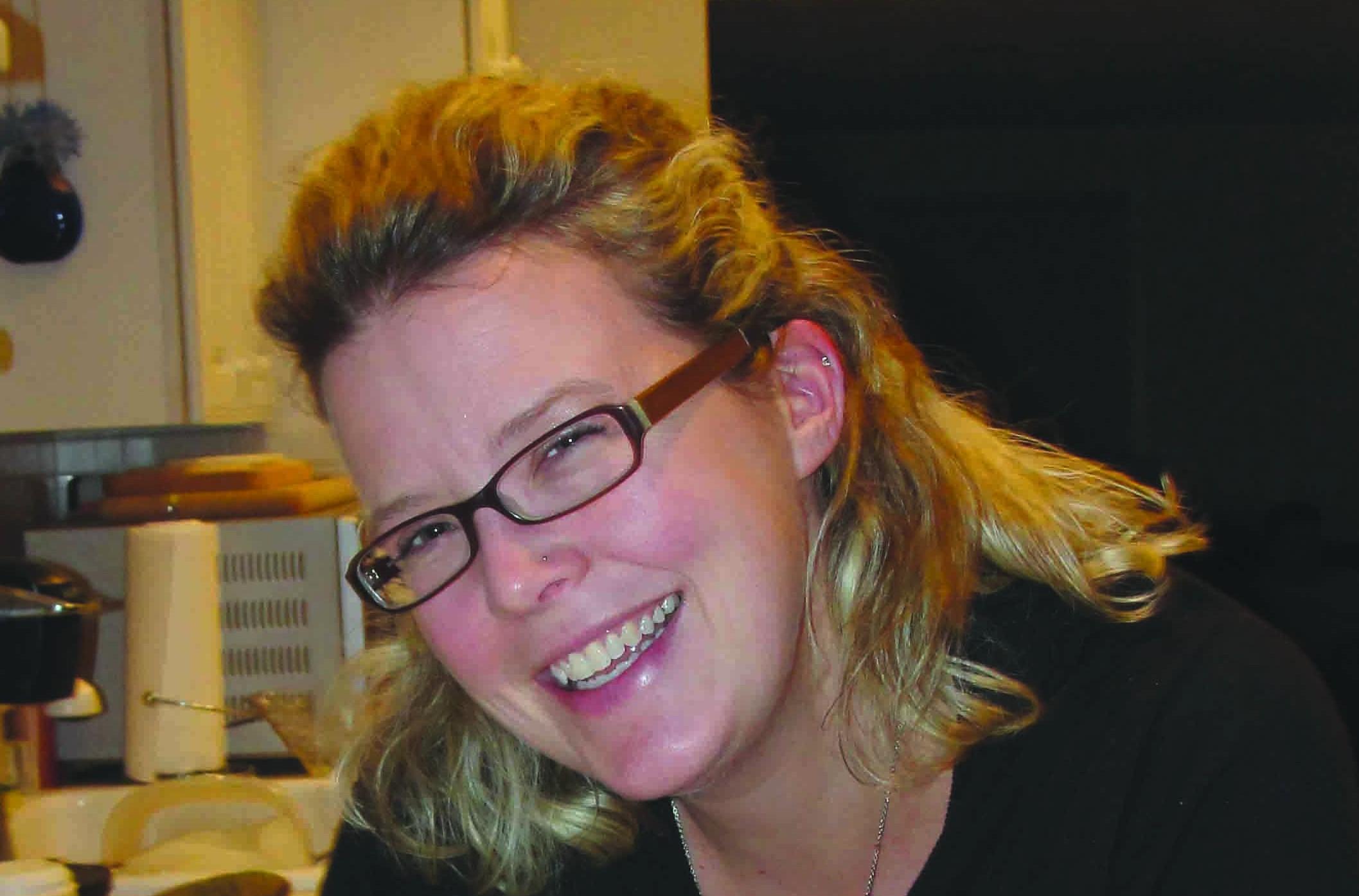English teacher Tracy Harmon elaborately ices sugar cookies.