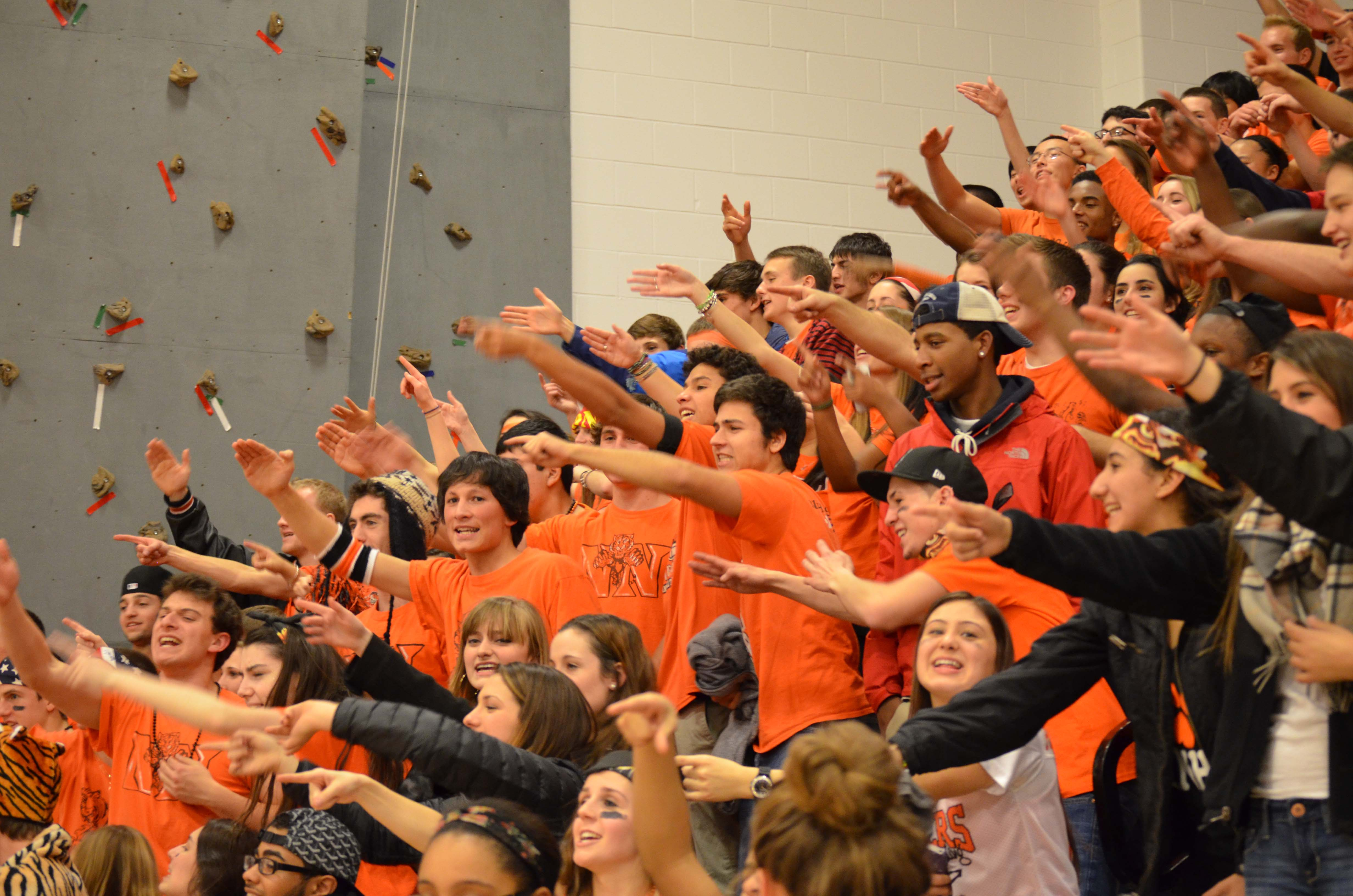 During a boys' basketball game, senior cheer on the Tigers as part of the 6th Man tradition.