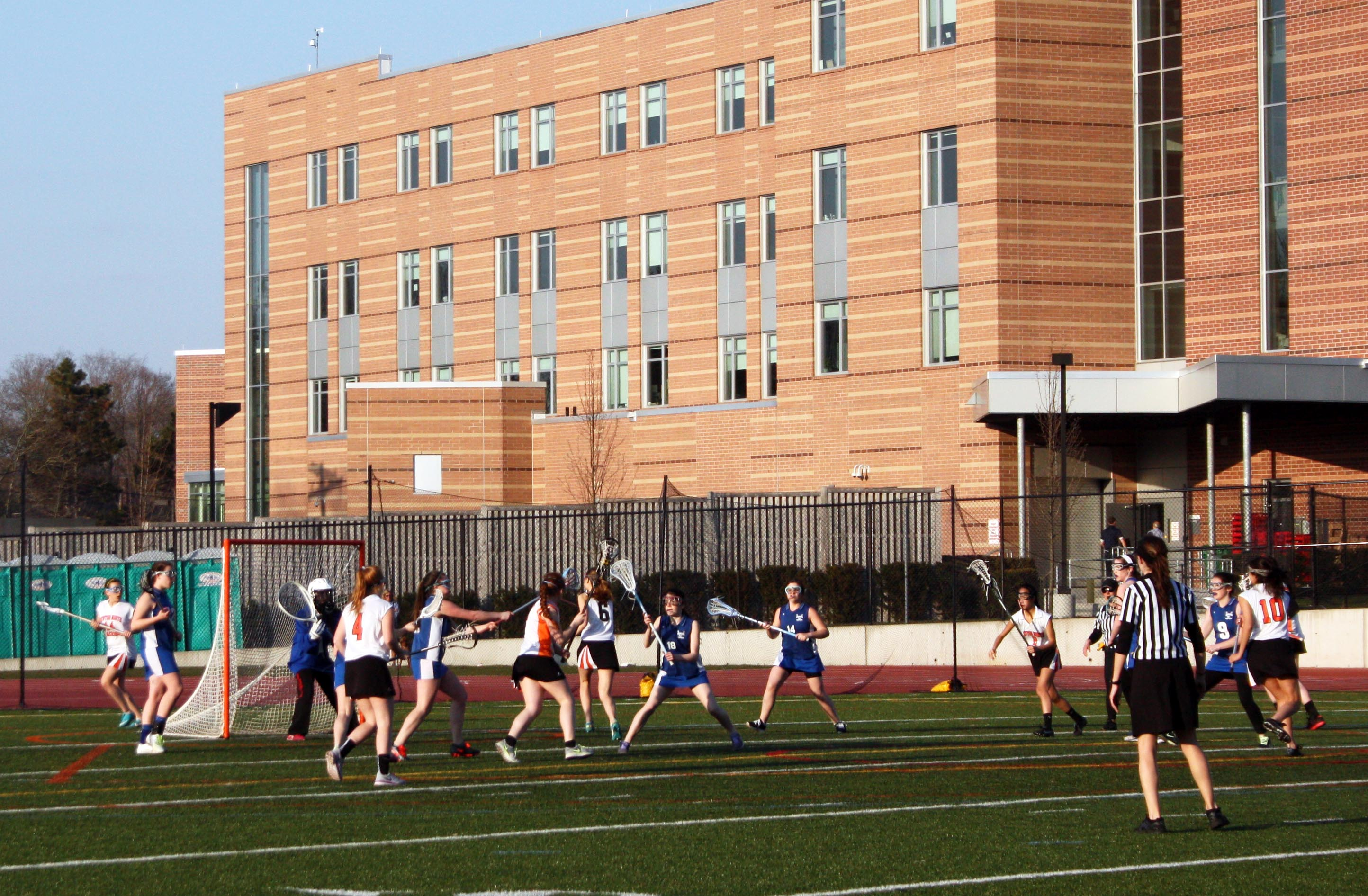 The Girls' Lacrosse team practices for a game.