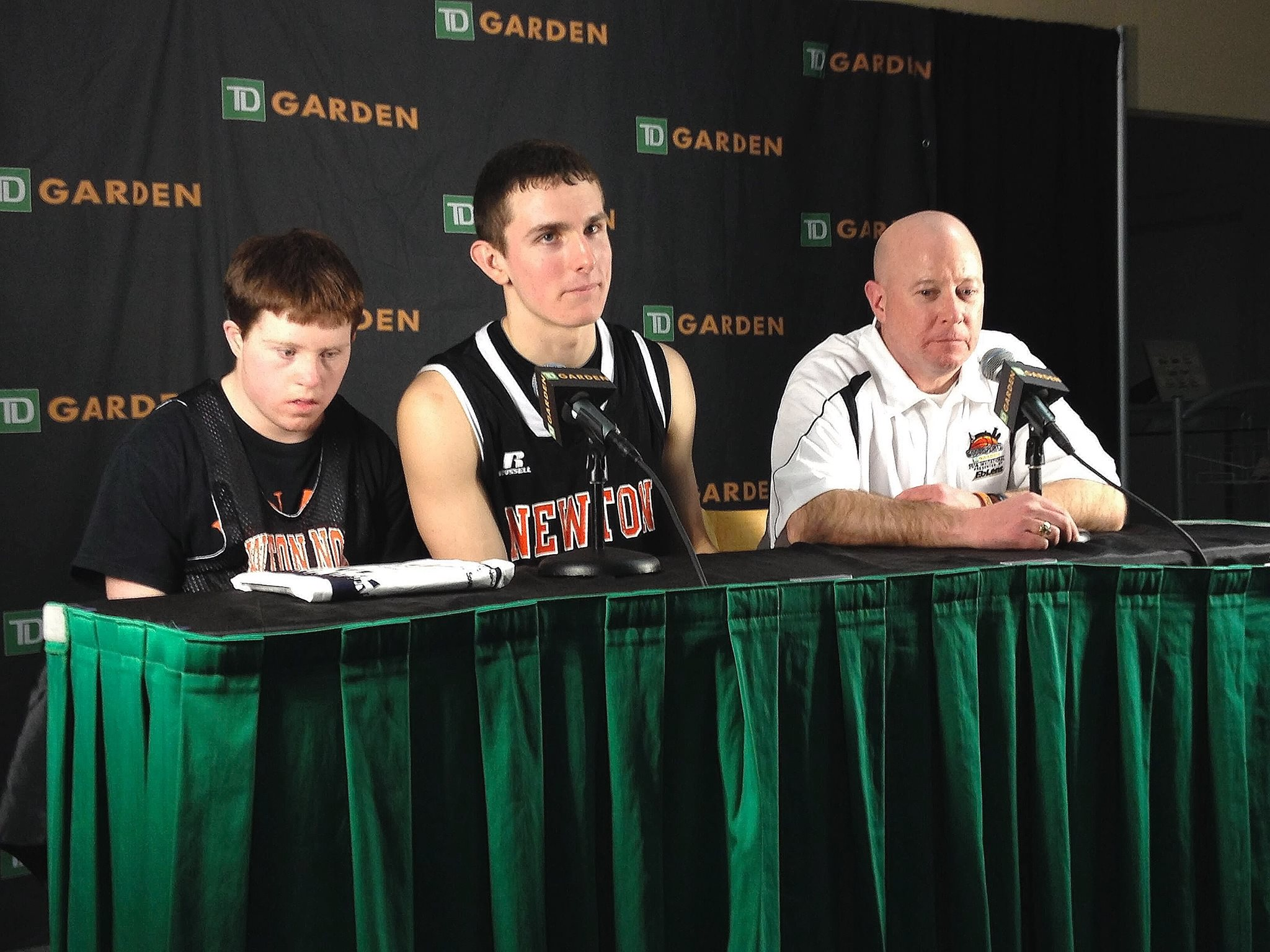 Team manager Brendan Durkin, junior captain Tommy Mobley, and basketball coach Paul Connolly fielding questions at last Saturday's Good Sports Invitational press conference. Photo by Jacob Gurvis.