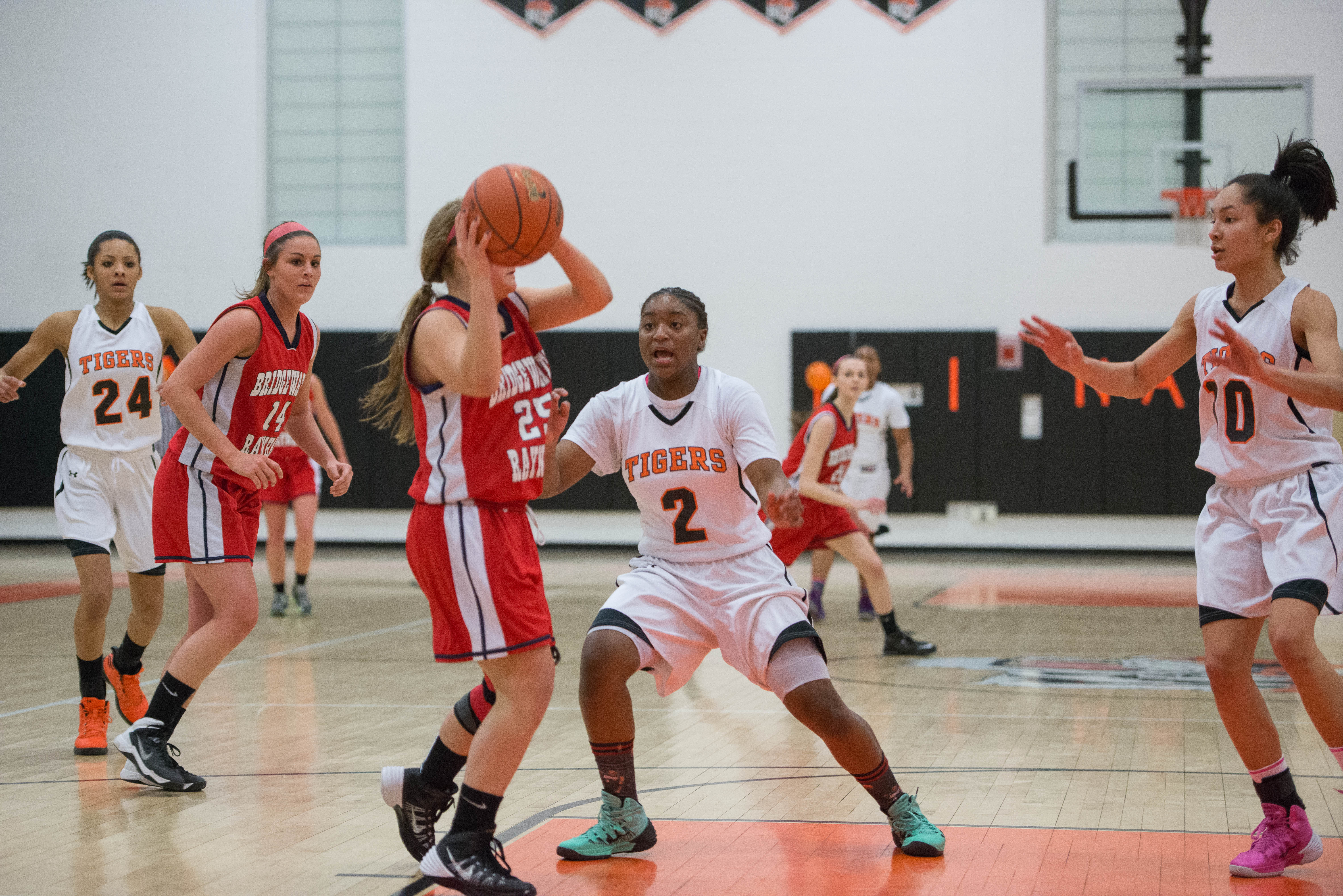 Freshman Sayawni Lassiter defends against Westford Academy on Tuesday