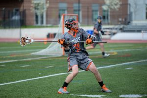 Boys' Lacrosse competes against Natick May 5.