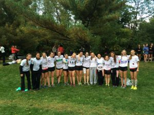 Girl's cross country seniors pose for a picture. Courtesy of Laura Schlossman.