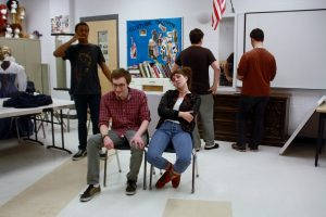 Senior Jelani Asim, junior Aaron Schwartz, senior Natalie Tereshchenko, freshman Andrew Hastings, and junior Jackson Bunis practice a sketch. Photo by Devin Perlo.