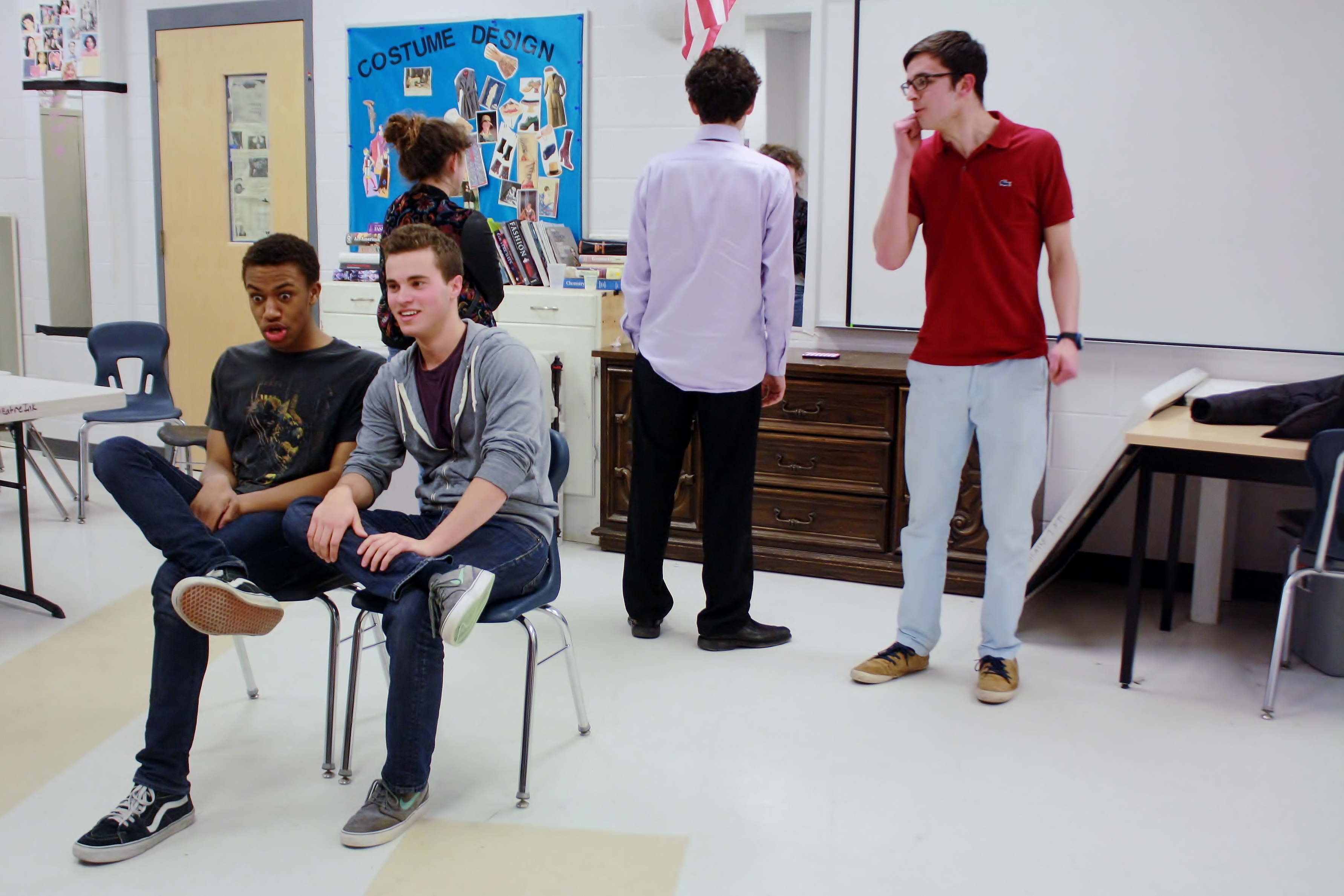 The cast of Spontaneous Generation rehearses one of its improvisational games. Photo by Devin Perlo.