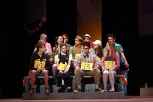 Contestants anxiously await their turn at the spelling bee. Photo by Devin Perlo.
