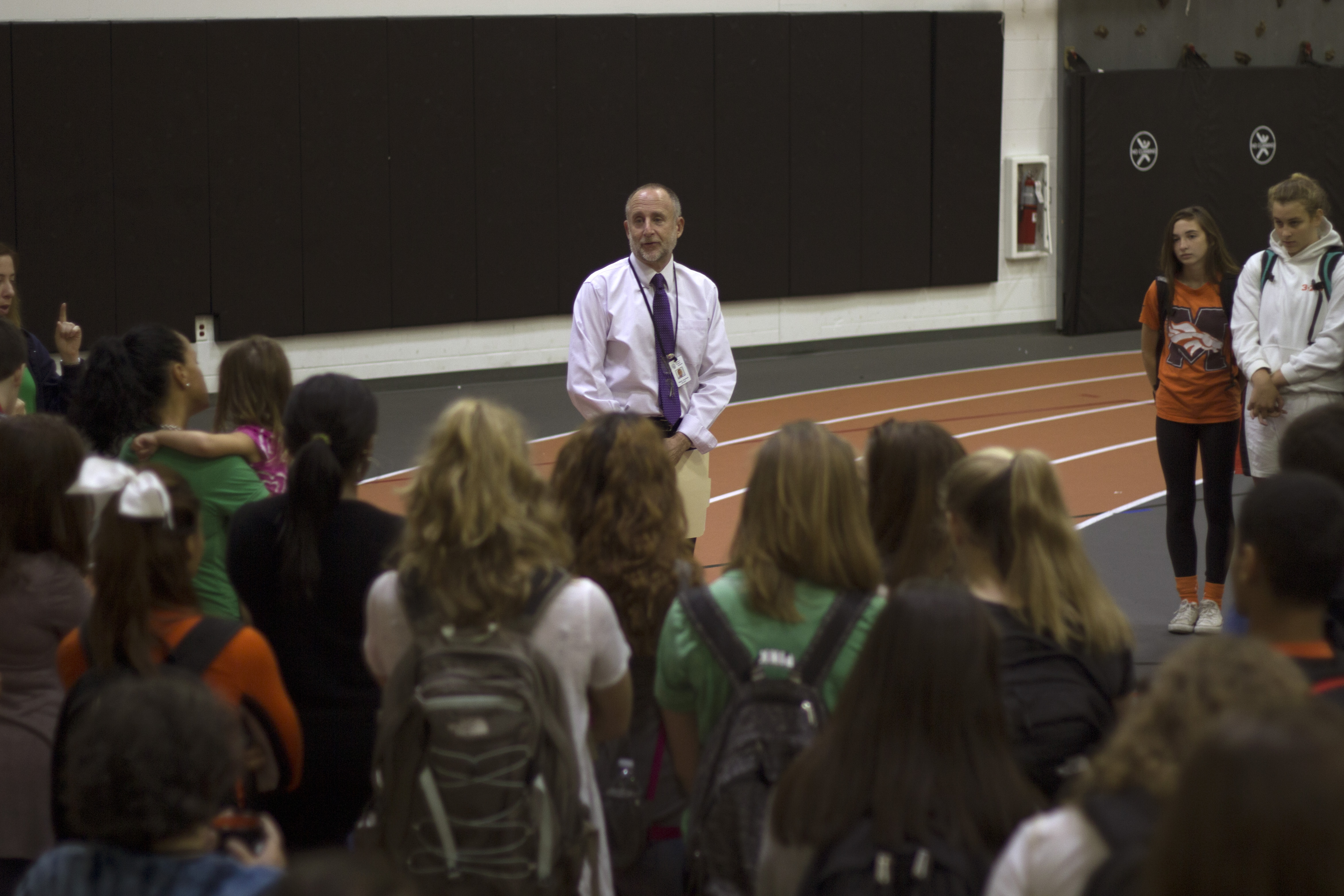 Interim principal Mark Aronson speaks to students in the SOA before the moment of silence. Photo by Josh Shub-Seltzer.