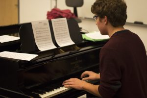 This year's pianist, Brendan King, rehearses one of the songs with the cast of Freshman Cabaret.