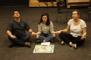 Director and senior Jackson Bunis and juniors Annabelle Tocco and Natalie Cotter rehearse a sketch for Nitrous Oxide.