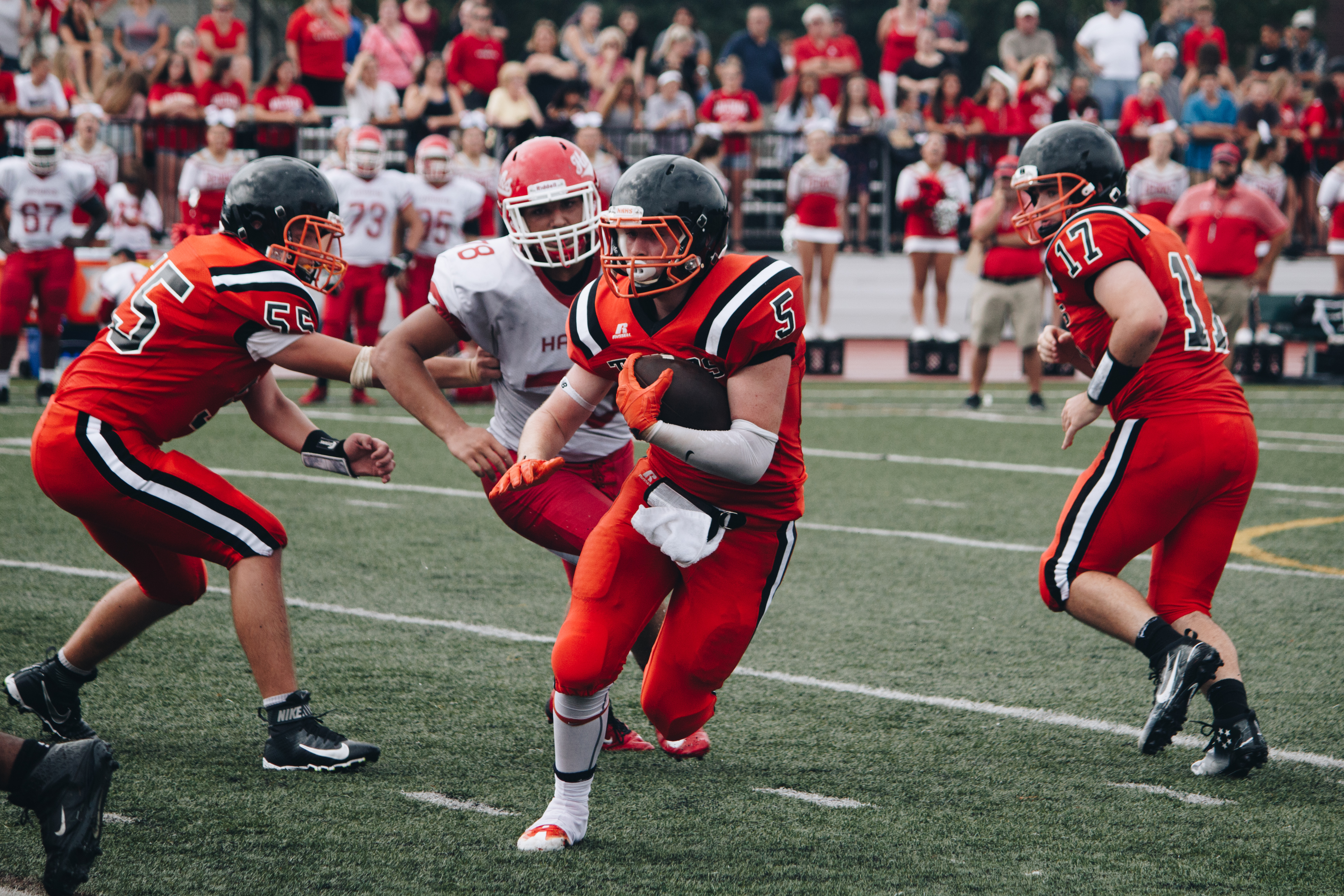 Senior Jimmy Hodgson rushes the ball in a 9-7 victory against Waltham last Saturday, September 10.