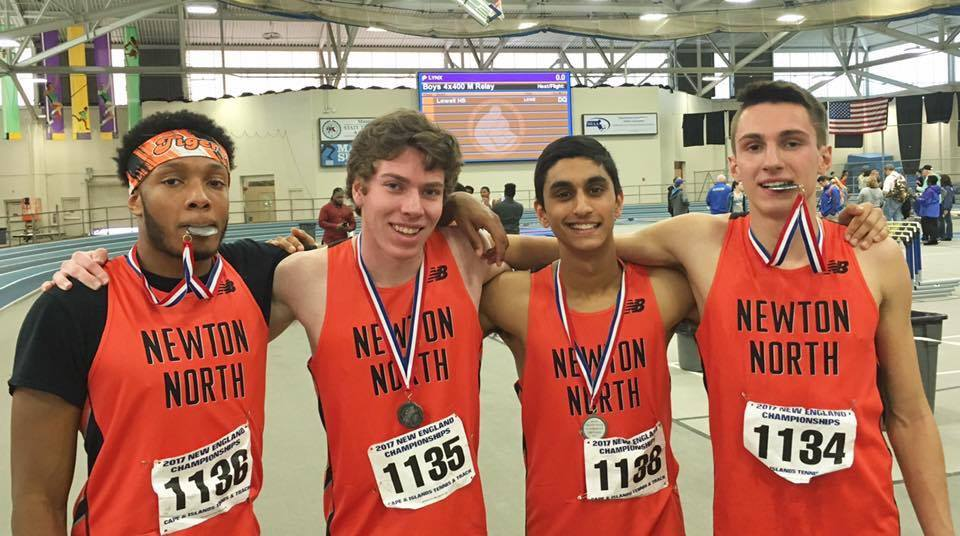 The boys' 4x400 meter relay team poses for a picture after their school record-breaking race, placing second in the meet. Left to right: senior Jordan Greene, junior Devin Coughlin, freshman Ragav Kadambi, sophomore Theo Burba. Photo courtesy of Brian Burba.